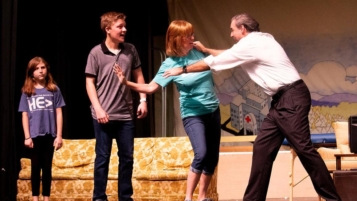 Left to right: Isabella Paysinger as Matilda Wormwood, Sandy Nienaber as Mrs. Wormwood, Jeff Ward as Mr. Wormwood and Eli Berney as Michael Wormwood perform a scene for 'Matilda the Musical.'