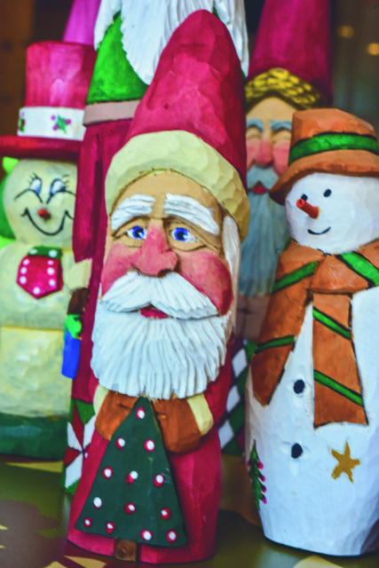 Maurice Vanhook is well known for his carved Santa Clauses.